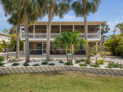 Sun Castle, our large Key West Style Family Vacation home with Private Pool and Hot Tub, All new decor, wood floors and Granite Kitchen