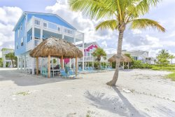 Direct Beachfront Vacation Home overlooking Fort Myers Beach from Decks on 2 Levels with Shared Pool
