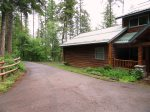 Front View of Log Home with Driveway