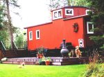 The Caboose, Outside View in Summer with Deck, Grill and Chimera, Sweet Little Spot Close to Town of Whitefish