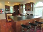 Kitchen with Bar Stools, View is from the Dining Area