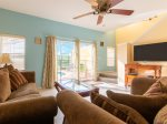 Great Room with Large TV with View of the Pool Deck