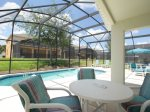 Covered Lanai with Two Tables on Large Private Pool Deck
