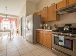 Fully Equipped Kitchen with Stainless Steel Appliances, Bar, and Breakfast Nook