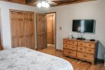The king master suite has a tv, private access to the lakefront deck