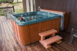 Ma Cook Lodge has a hot tub on the lower deck overlooking Norris Lake