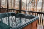 Relax in the lakefront deck hot tub at Ma Cook Lodge