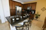 San Felipe Rental condo - Dining table and adjacent kitchen