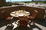 Patio dining with views of the golf course and beach