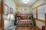 Bunk room with adult twin over full mattresses and twin trundle located downstairs.