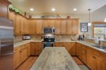 Well equipped kitchen and lots of granite top counter space.