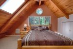 King size bed in loft with attached bath.