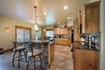 Beautifully equipped kitchen with stainless appliances.
