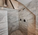 Artisan crafted walk in shower with bench.