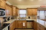Efficient and well equipped kitchen with nice prep space.