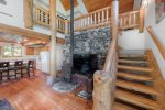 Wood burning stove, big screen TV.  Nicely crafted, log stairwell.
