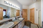 Attached, master bath has his and her sinks.