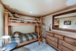 Guest bedroom 2 has a twin over twin size bunk set.