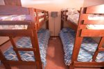Half wall loft with private door has two bunk sets.