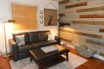 Downstairs Bedroom / Lounge - lovely blue pine accents.