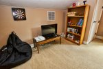 Upstairs loft area for the young ones to hang out, play XBOX, watch TV or Read