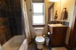 Upstairs guest bathroom. Attached guest bedroom has additional hall access.