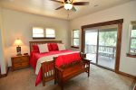 Upstairs master suite has king bed and attached bathroom.