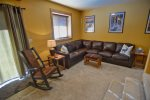 Basement level has cozy furnishings and outdoor patio access.