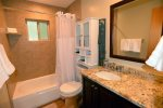 Downstairs, hall access tub/shower combo bathroom.