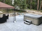 Payette River McCall Vacation Rental Cabin with hot tub on patio deck