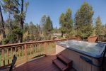 Well maintained hot tub is located between living area and Master Suite access doors.