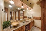 Master bathroom with dual sinks, large tub.