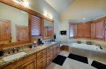 Master Suite attached bath with twin sinks,  soaking tub and TV too.  Lovely views.