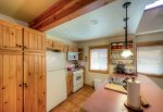 Kitchen layout is compact and efficient.   Note appliances updated to stainless.