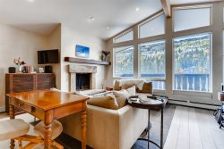 Fabulous top floor corner location with panoramic views of Vail ski slopes.
