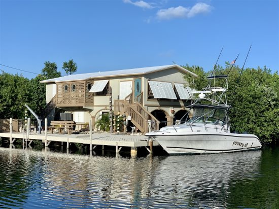 Calypso Corner with plenty of beautiful dock space and a large yard