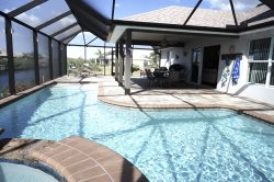 Marianne - Cape Coral 4br/2ba home w/electric and solar heated pool/spa, gulf access canal, HSW Internet, boat dock
