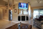 Family room with tv and pass thru kitchen