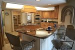 Kitchen with granite counter tops and bar