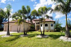 Laguna del Sol - Cape Coral 3b/2.5ba  luxury home w/solar heated pool, gas fire place, gas kitchen cook top, outside kitchen with gas bbq grill, gulf access canal, HSW Internet, Boat Dock