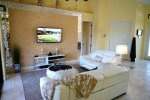 Family room with electric reclining sofas and tv
