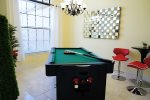 Game room with multi use pool-ping pong-air hockey table