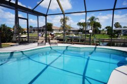 Hibiscus - SW Cape Coral 3b/2ba electric heated pool home, gulf access canal, Boat Dock, HSW Internet,