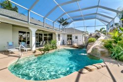 Villa MAXINE - 4 Bed/2.5 Bath Waterfront Home with Pool and Spa, Amazing pool area with slide, Boat Dock with Lift.