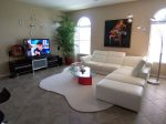 Contemporary furnished family room with tv