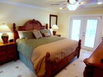 Master bedroom with tv and king bed