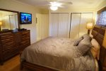 King master suite with tv and access to patio and pool