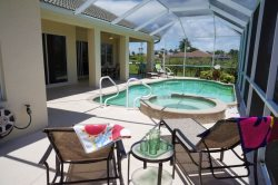 Tropical Haven - Cape Coral 4 b/2.5 ba  deluxe home w/electric heated pool/spa, gulf access canal, HSW Internet, Boat Dock