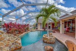 Villa Sun Splash - Cape Coral 3b/2 1/2ba with home with den, w/electric heated pool/spa, water slide, gulf access canal, HSW Internet, Boat Dock