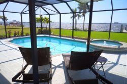 Edith Esplanade - Cape Coral 3b/2ba  Deluxe Home, River Front, w/Electric Heated Pool/Spa,  HSW Internet, Boat Dock with Lift